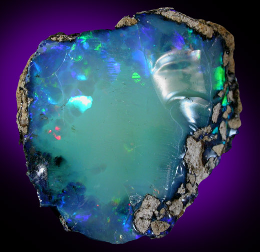 Photographs of mineral No. 44834: Opal (var. Crystal Fire
