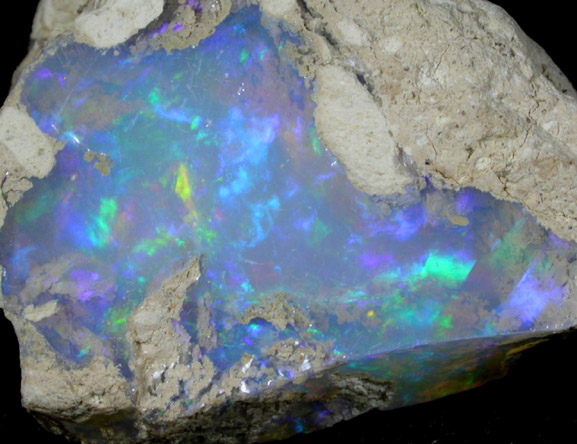 Photographs of mineral No. 44833: Opal (var. Crystal Fire