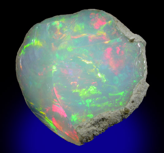 Photographs of mineral No. 44116: Opal (var. Crystal Fire